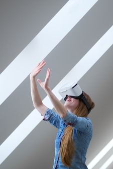 Redhead girl with virtual reality glasses