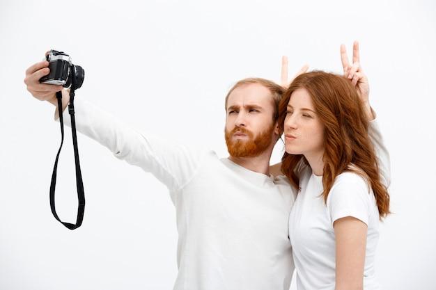 Redhead happy man and woman take selfie