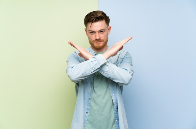 Redhead man over colorful  making no gesture