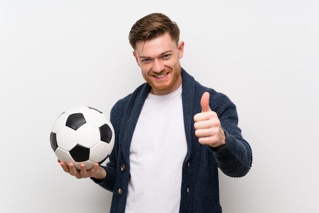 Redhead man holding a soccer ball