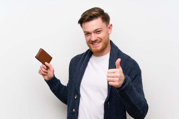 Redhead man holding a wallet