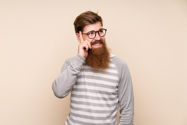 Redhead man with long beard with glasses