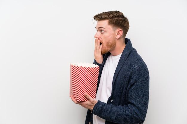 Redhead man with popcorns