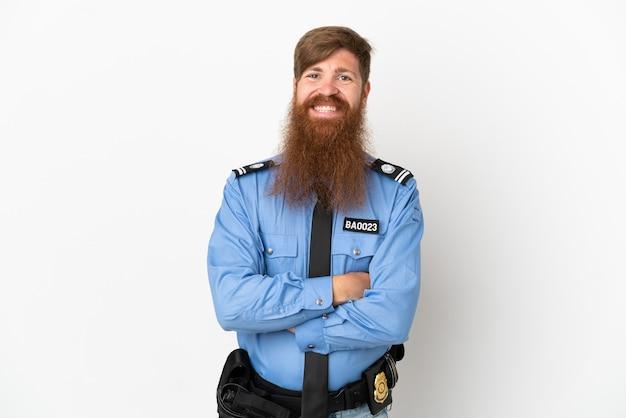 빨간 머리 경찰 남자는 정면 위치에 팔을 교차 유지 흰색 배경에 고립
