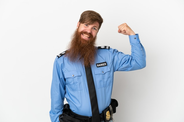 Redhead police man isolated on white background doing strong gesture