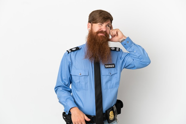 Redhead police man isolated on white background having doubts and with confuse face expression