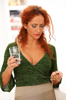 Redhead woman drinking water