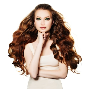 Redhead woman. fashion model with red curly hair isolated on white background