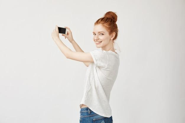 Redhead woman holding phone