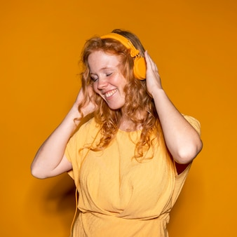 Redhead woman listening to music
