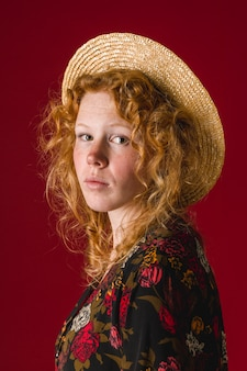 Redhead woman looking at camera