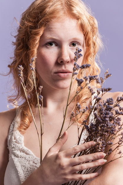 Redhead woman posing while holding a bouquet of lavender
