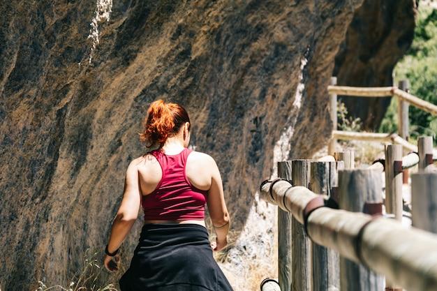 Redhead woman walking at los cahorros, granada, spain