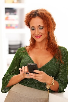 Redhead woman with mobile phone
