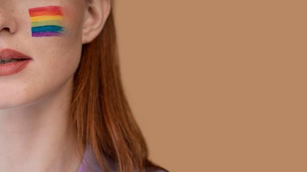 Redhead woman with rainbow symbol