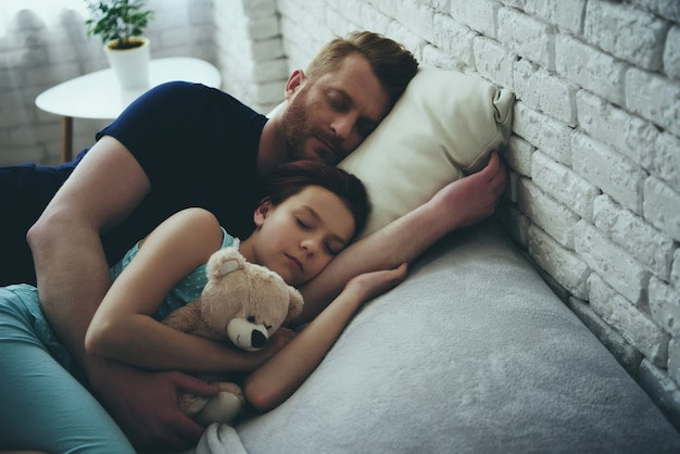 Redheaded single father and daughter are sleeping.