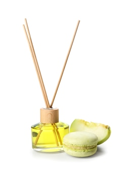Reed diffuser, apple and cake on white background