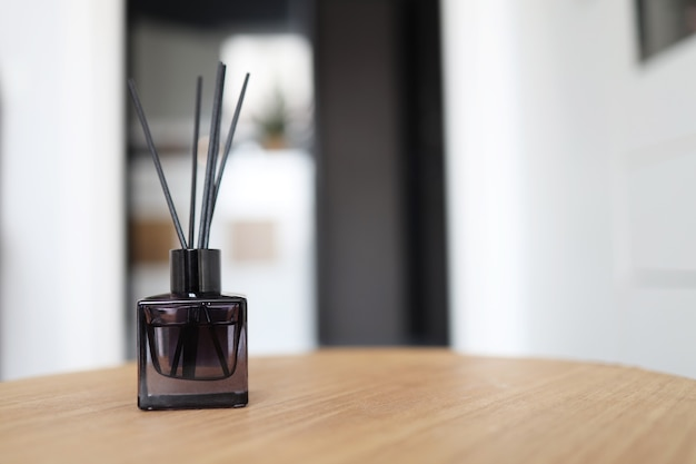 Reed freshener on table in light room, closeup