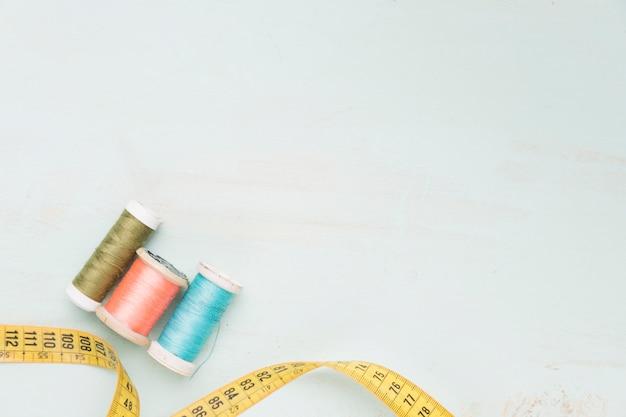Reels of yarn and measuring tape