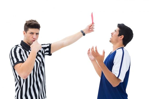 Referee sending off football player