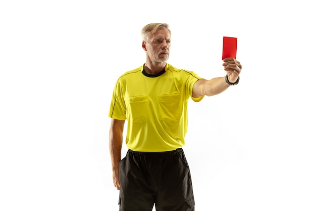 Referee showing a red card to a displeased football or soccer player while gaming isolated on white wall.