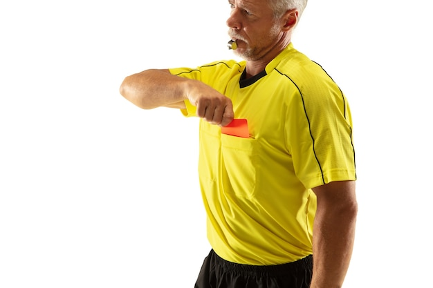 Referee showing a red card and gesturing to a football or soccer player while gaming isolated on white wall.