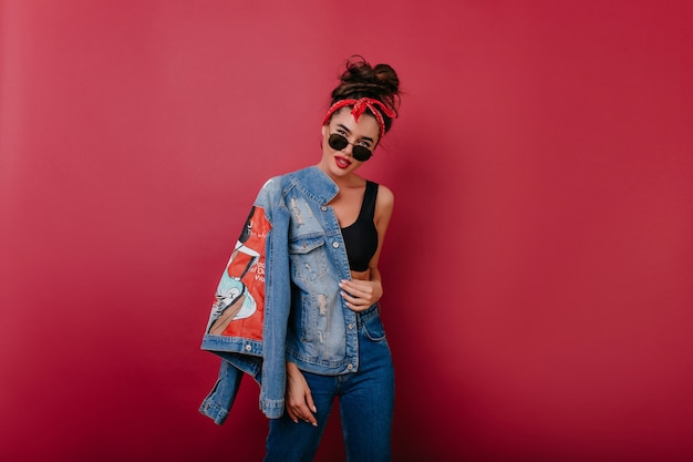 Refined caucasian girl in blue denim jacket posing