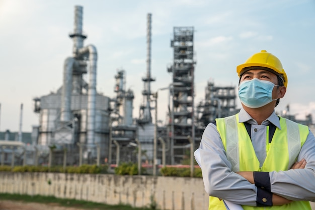 Refinery industry engineer  wearing co protective coronavirus disease starting in 2019 or covid-19mask sading because because of being unemployed