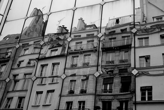 Reflection of buildings in paris france