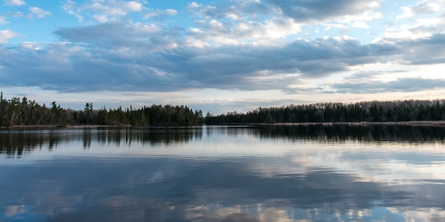 Reflection of clouds on water, lake of the woods, ontario, canada