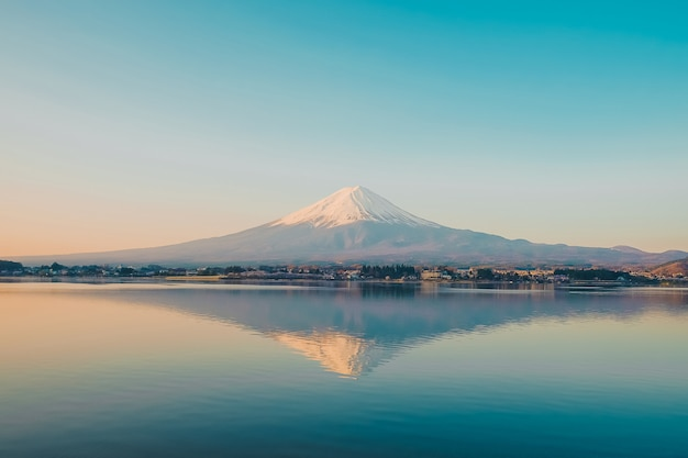 Reflection of fuji mountain with snow capped in the morning sunrise
