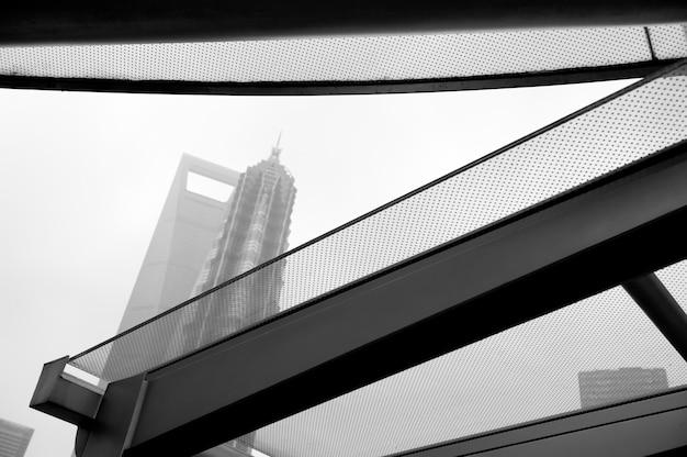 Reflection of jin mao tower on a window glass, lujiazui, pudong, shanghai, china
