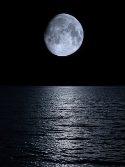 Reflection of the moon over the calm sea