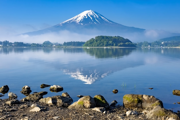 Reflection of mt. fuji with rock shore foreground, kawaguchiko lake, yamanashi