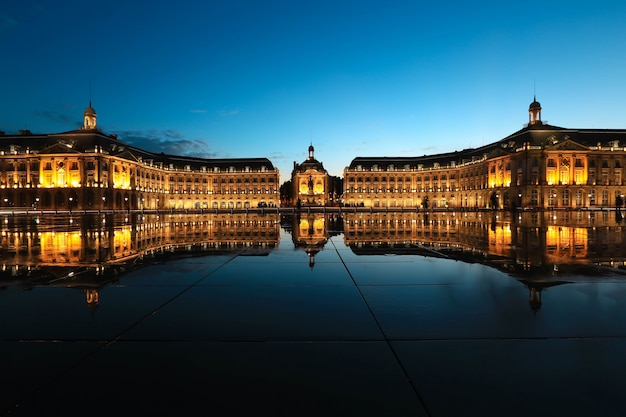 Reflection of place de la bourse in bordeaux, france.