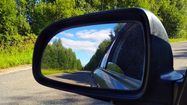 Reflection of the road in the car mirror