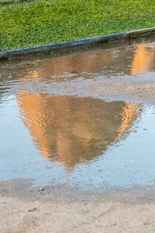 Reflection of sugarloaf mountain in a puddle of water in rio de janeiro, brazil.