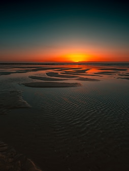 Reflection of the sunset in the ocean captured in domburg, netherlands
