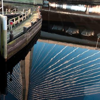 Reflection of the zakim bunker hill bridge in boston, massachusetts, usa