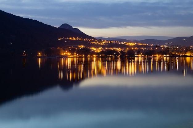 Reflections on lake, caldonazzo lake, italy. italian landscape.