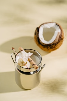 Refreshing alcoholic coconut cocktail in tropical style