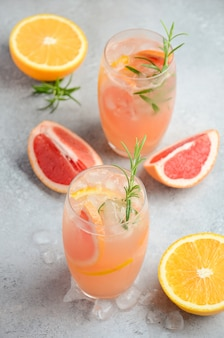 Refreshing citrus cocktail with grapefruit, orange and rosemary.