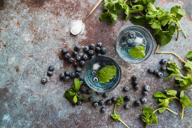 Refreshing cold drinks with blueberries and mint