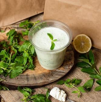 Refreshing cold yogurt shake with herbs and mint, ayran