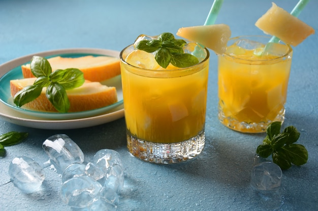 Refreshing drinks and citrus juices  with ice cubes, mint and melon. summer concept