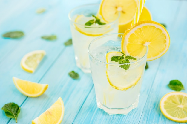 Refreshing drinks for summer, cold  lemonade juice with sliced fresh lemons
