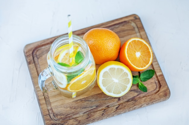 Refreshing fruit cocktail with lemon, orange and mint. summer and party.
