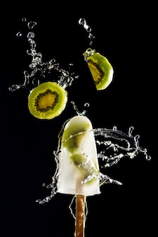 Refreshing fruit ice with kiwi and water splash