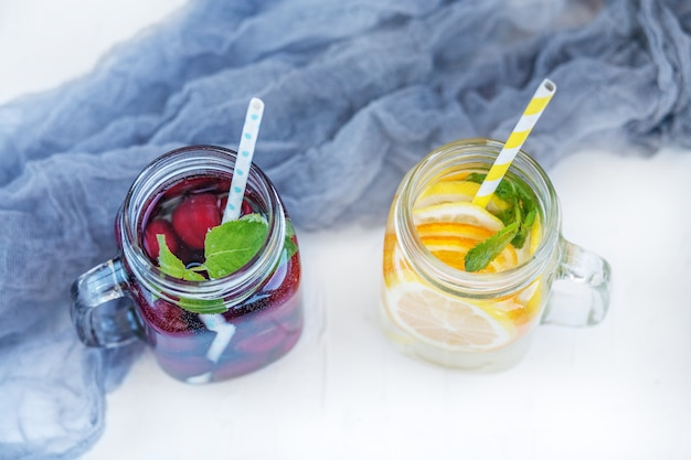 Refreshing fruit water in a glass jar. summer and party.