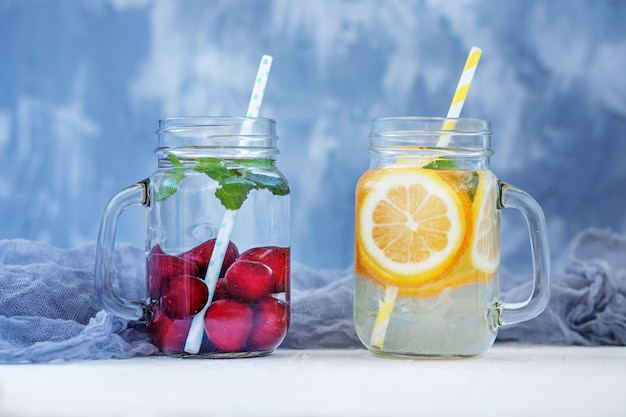 Refreshing fruit water in a glass jar.